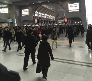 Shinagawa train station in the late morning. Trying to cross the traffic requires strategy and deliberate action.