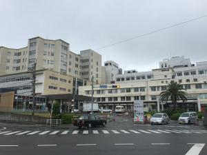 Outside the hospital on a rainy day.