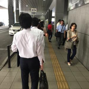 Queue of people to get into Shinagawa station  on the single-passenger escalator.
