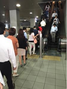 Queuing to get inside Shinagawa train station