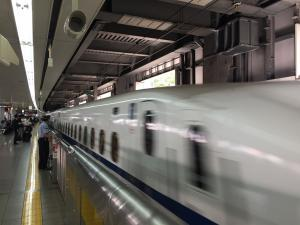 Shinkansen bullet train arrives at Nagoya station.