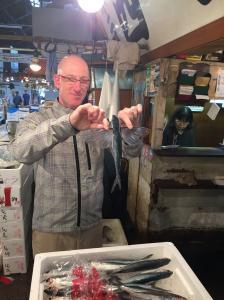 Andy showing us some of the fresh fish of the day - much of what we got to eat that night at the restaurant!