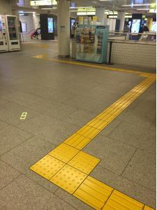This yellow raised pathway runs throughout the city of Tokyo - in stations, on most major sidewalks, and near building.