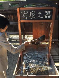 My colleague Nami-san demonstrating how the students at Japan's first school, located in Ashikaga, would learn discipline and humility by mastering how to pour the water precisely - just enough but not too much to dump it out.